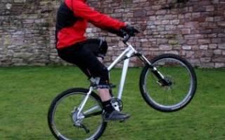 Как на велосипеде поднять переднее колесо